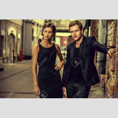 42791029-fashion-style-photo-of-a-beautiful-couple-over-city-background-